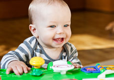 Cute baby boy playing at home Stock Image
