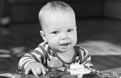 Cute baby boy playing at home Stock Images