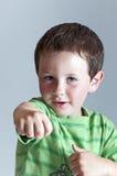 Cute baby boy playing karate Stock Image