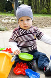 Cute Baby Boy Playing Outdoors Stock Images
