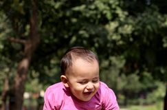 Cute baby boy playing in the park. He is very happy looking cute Royalty Free Stock Photo