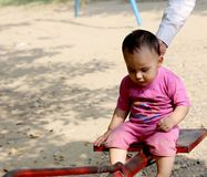 Cute baby boy playing in the park. He is very happy looking cute Stock Image