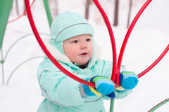 Cute baby boy playing in park in winter Royalty Free Stock Photos