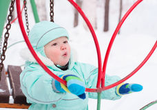 Cute baby boy playing in park in winter Royalty Free Stock Images