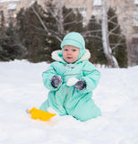 Cute baby boy playing in park in winter Royalty Free Stock Photography