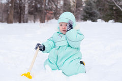 Cute baby boy playing in park in winter Stock Photos