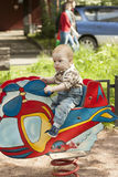 Cute baby boy playing at playgroun Royalty Free Stock Photos