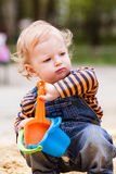 Cute baby boy playing with sand. In a sandbox Stock Images