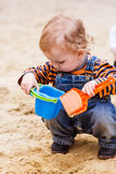 Cute baby boy playing with sand. In a sandbox Royalty Free Stock Photo