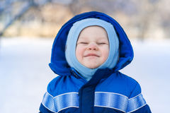 Cute baby boy playing with snow toy shovel. In winter outdoor Royalty Free Stock Photography