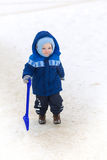 Cute baby boy playing with snow toy shovel Stock Photography
