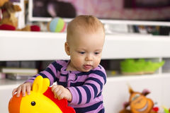 Cute baby boy playing with a toys Stock Image