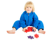 Cute baby boy plays with construction set Stock Photo