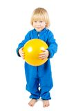 Cute baby boy plays with yellow ball Stock Photography