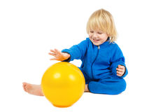 Cute baby boy plays with yellow ball Stock Image