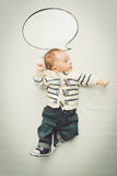 Cute baby boy posing with empty speech bubble. Portrait of cute baby boy posing with empty speech bubble stock photos