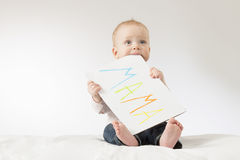 Cute baby boy with poster. Concept for postcard to Mothers day. Copy space. Colorful sign Mama.  Royalty Free Stock Images