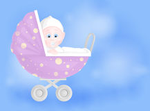Cute baby boy  in pram. On blue background Royalty Free Stock Photos