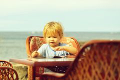 Cute baby boy reads menu card royalty free stock photos
