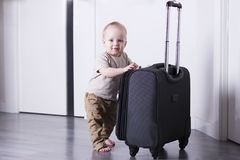 Cute baby boy ready for a crusie. Smiling infant kid going to a trip.  Stock Photo