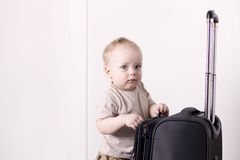 Cute baby boy ready for a crusie. Smiling infant kid going to a trip. Copy space.  Royalty Free Stock Image