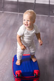 Cute baby boy ready for a crusie. Smiling infant kid going to a trip.  Royalty Free Stock Image