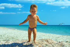 Cute baby boy running the beach Stock Photo