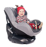 Cute baby boy in safety car seat over white Royalty Free Stock Image