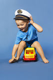 Cute baby boy with sailor hat. Blue bacground Royalty Free Stock Image