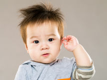 Cute baby boy salute Royalty Free Stock Photography