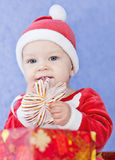 Cute baby boy santa helper Stock Photos
