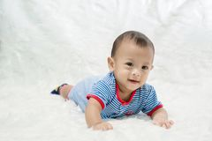 Cute baby boy is shooting in the studio. fashion image of baby and family. royalty free stock image
