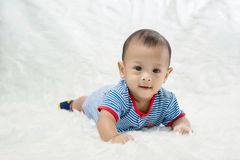 Cute baby boy is shooting in the studio. fashion image of baby and family. royalty free stock photos