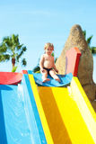 Cute baby boy sits on top of waterslide Royalty Free Stock Photography