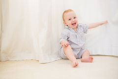 Cute baby boy sitting on floor Stock Photography