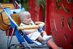 Cute baby boy sitting in stroller Royalty Free Stock Photos