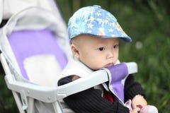 Cute baby boy sitting in stroller Royalty Free Stock Photo