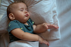 Cute baby boy sleeping on the bed at home Stock Photo