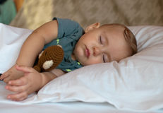 Cute baby boy sleeping on the bed at home Royalty Free Stock Photos