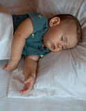 Cute baby boy sleeping on the bed at home Royalty Free Stock Photo