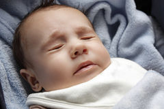 Cute baby boy sneezing Stock Photos