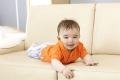 Cute baby boy on sofa Stock Images