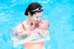 Cute baby boy in swimming pool with his mother Stock Photos