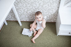 Cute baby boy with telephone Royalty Free Stock Image