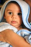 Baby in bath towel royalty free stock images