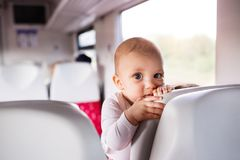 Cute baby boy travelling by train. Railway journey of a little infant boy Stock Photo
