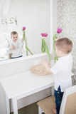 Cute baby boy with tulip Stock Photography