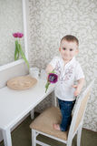 Cute baby boy with tulip Stock Image