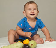 Cute baby boy with vegetables Royalty Free Stock Photos