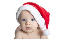 Cute baby boy wearing christmas cap Stock Image
